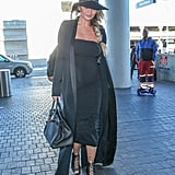 The jet-setting star wore an all-black ensemble to the airport complete with coordinated black hat, Birkin bag, and lace-up sandals.