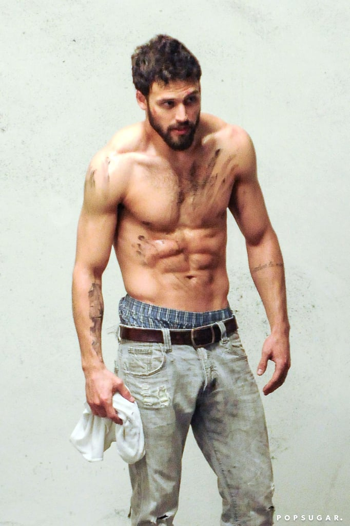 Ryan Guzman was randomly spotted shirtless in an LA parking garage on Wednesday, and while first glances made us think he was involved in some sort of fight club, a closer look made it clear that the actor was doing a photo shoot. Ryan, who stars in Heroes Reborn and played Jennifer Lopez's supersexy neighbor in 2015's The Boy Next Door, showed off his insanely chiseled six-pack while smoking, stretching, and doing push-ups for the camera. We're not at all complaining about this addition to his hottest photos. Keep reading to see Ryan's steamy shirtless snaps, then check out all the times his flirty smile made you giggle like a schoolgirl.