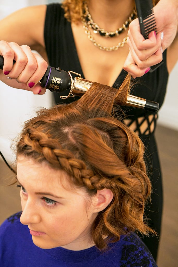 Let down the top section of hair to conceal the end of your braid, and add in more waves with your curling iron.