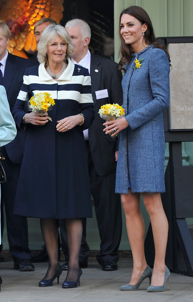 Kate Middleton looked ready for Spring in gorgeous bright blue as she stepped out alongside the Queen and Camilla, Duchess of Cornwall, for tea at Fortnum & Mason food store in London today. Catherine, Duchess of Cambridge, wore a jacket by Missoni, pumps by Rupert Sanderson, and accessorized with two yellow daffodils on her lapel in honor of St David's Day. The trio of royal women were presented with special picnic baskets in honor of the Jubilee. Inside the upscale department store, Kate reportedly indulged in chocolate, confessing to the staff that like most girls she has a sweet tooth. The gift baskets Catherine, Camilla, and the Queen received reportedly included dog biscuits, which may have been specially included with Kate and William's new puppy Lupo in mind. Catherine has been coming into her own with solo appearances while her husband Prince William is on duty in the Falklands. The Jubilee events and her charity work have kept her busy, but she has her own special occasion around the corner as well — Kate and William's first wedding anniversary is just two months away already.