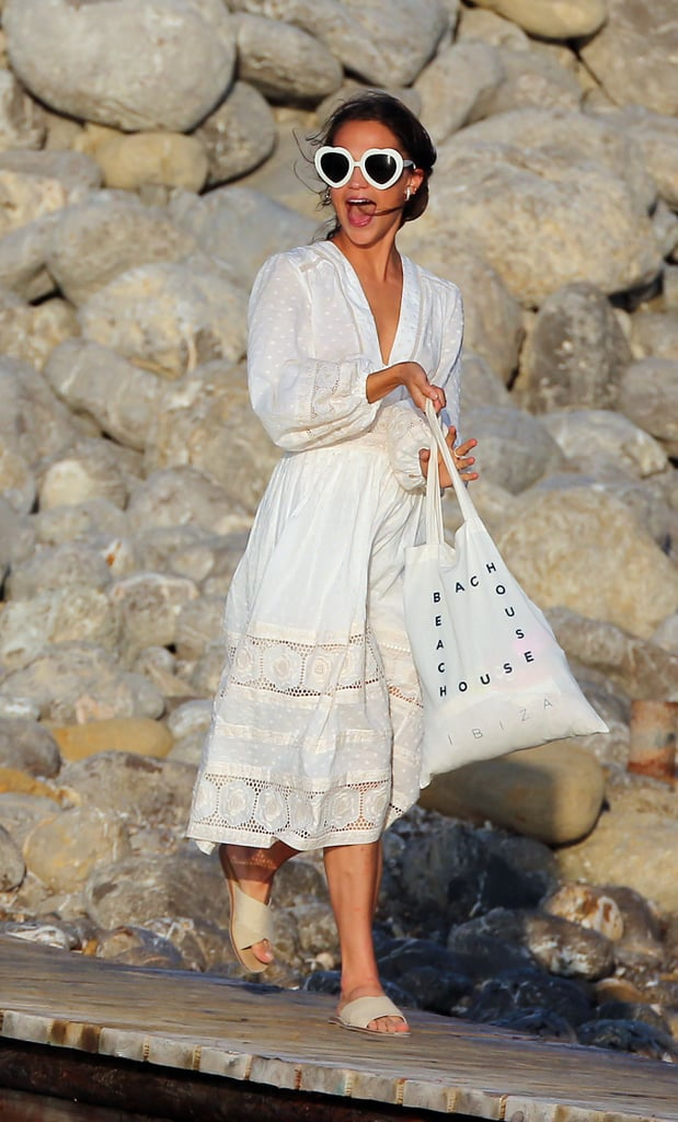 Alicia Vikander and Michael Fassbender got married in Ibiza over the weekend in the most private ceremony. Though there are no photos of the party or Alicia's dress, we know at least one thing she packed for her wedding weekend. The star stepped out the day before in a white prima cotton sundress by Zimmermann ($795). She wore a billowy, long-sleeved lace number and walked along the beach in a pair of taupe crisscross sandals.  The actress looked carefree and happy as she snapped photos with friends and family. While it did seem like Alicia was merely on vacation, one of the biggest signs of her nuptials were her heart-shaped sunglasses. They were literally sending love signals. Only time will tell if we'll get a glimpse of Alicia's actual wedding look, but for now, check out her casual daytime ensemble.      Related:                                                                                                           Alicia Vikander May Be an Actress, but She Looks Like a Freaking Supermodel on the Red Carpet
