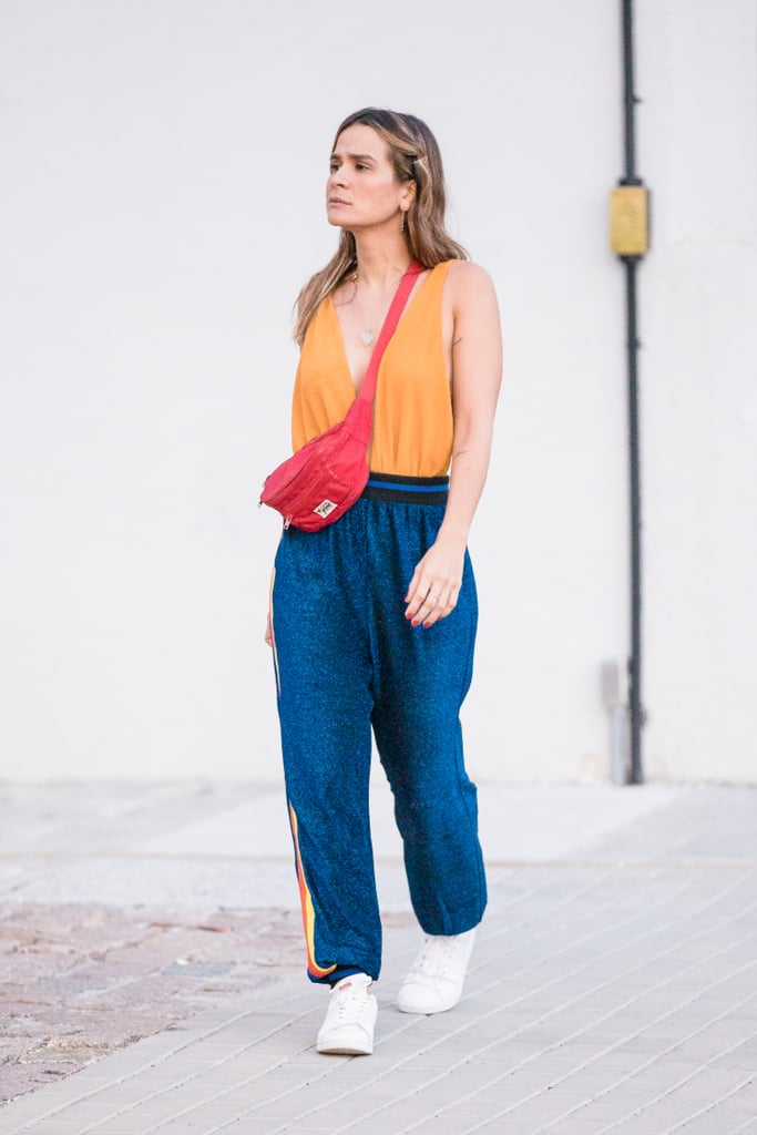 Style a Fanny Pack Around Your Striped Pants and Tank Top