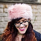 Sticking with all things furry, add some animal style to your head with a fluffy headband. Unlike a hat, you won't get too hot but you can still keep your hair in place. Wear with a cropped jacket, a-line skirt and ankle boots for extra pretty points.
