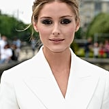 Usually one for more demure makeup looks, Olivia Palermo smudged a metallic navy shadow around her eyes for an alluring look at Dior.
