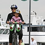 Luciana pedaled with one of her daughters along for the ride.