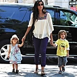 Camila held her little ones' hands on their way to the Central Park Zoo.