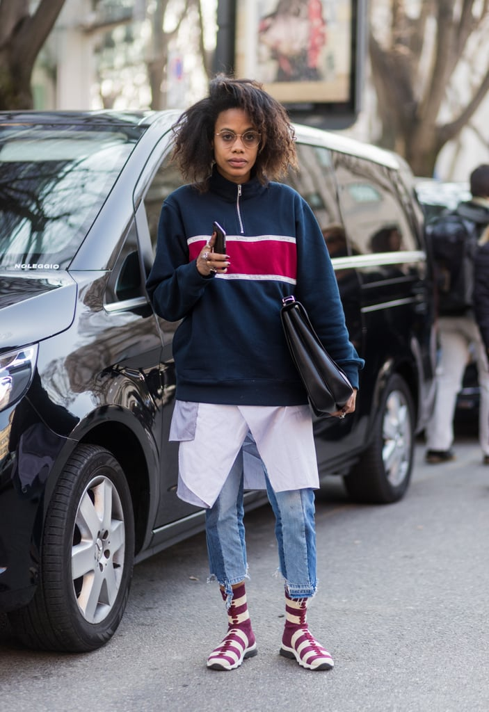 With comfy layers and cool kicks