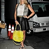 We love the mix here, but especially the accessories: a bold Givenchy satchel and black-and-white Bottega Veneta heels.