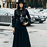 You can wear thick tights underneath a maxi dress without anyone knowing it. Cap off your look with a stylish hat, rather than a beanie, if your ears tend to get cold.