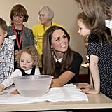 Kate Middleton listened intently to a little girl as she visited the offices of Child Bereavement UK in March.