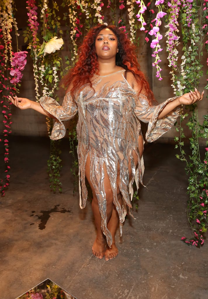 Did the little mermaid just walk onto the beach? Nope, it's just Lizzo looking spectacular in a costume-like shredded nude and silver dress reminiscent of a forest nymph.