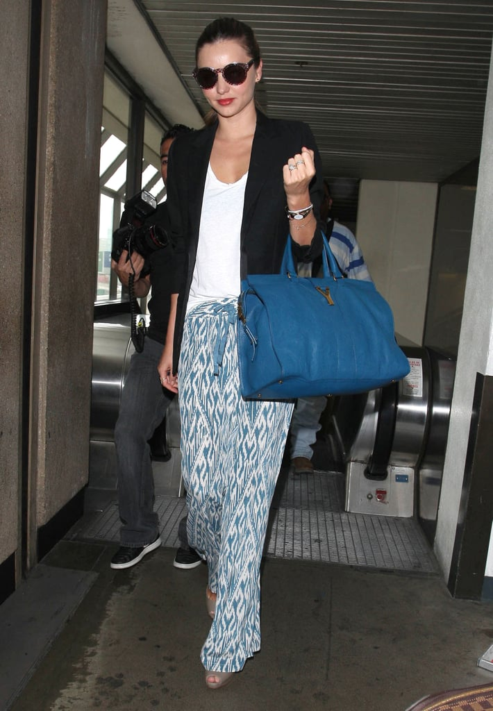 Miranda Kerr's printed Joie palazzo pants made a case for the easiest Summer style — and looking pulled-together at the airport.
