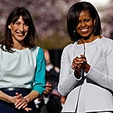 Michelle and Samantha smile at the arrival ceremony.