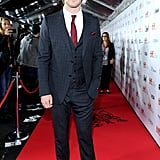 Chris Hemsworth suited up for the premiere of his F1 racing movie Rush.