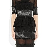 "It's hard for me to put into words how much I adore this Karl Lagerfeld Appliqued Mesh Dress ($3,910); it's basically a show piece, and in the words of Britney Spears, I'm a ""put-on-a-show"" kind of girl. While it's obviously a splurge, I think it's worth its weight in gold (or in this case, silver). I'd style it up with basic black pumps, a metallic clutch, and a seriously smoky eye. — Britt Stephens, assistant editor"
