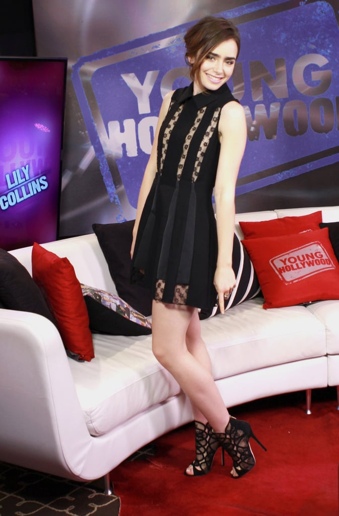 The actress stopped by the Young Hollywood studio, and again showed off her one part sweet, one part sexy styling formula in a babydoll dress and cage booties.