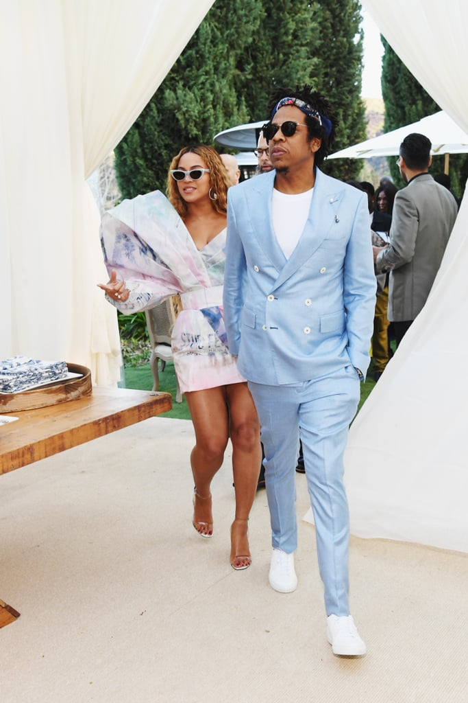 d78588b4ce9 Jay-Z is wearing Ray-Ban sunglasses with his blue suit.