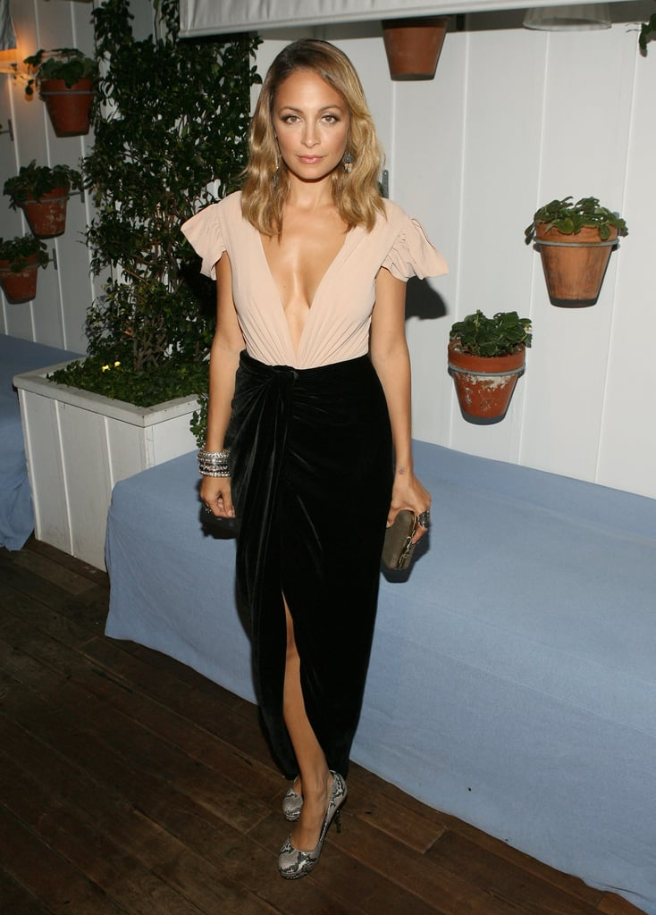 Nicole Richie played it a little retro with glamorous waves to match her feminine look at her cover party for DuJour.