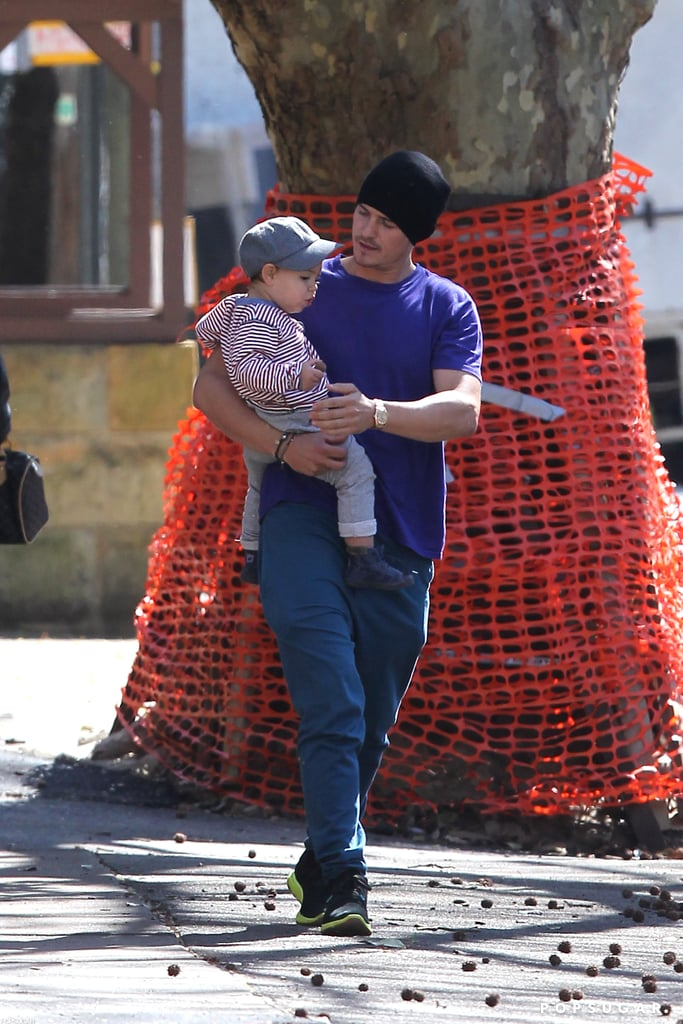 Orlando Bloom carried his son, Flynn, around Sydney yesterday. They both wore hats for the stroll and Flynn sipped on a drink. Orlando had wife Miranda Kerr as his walking companion over the weekend, when they hit the streets arm in arm. The family of three is back together in Australia following Orlando's visit to LA last week. Miranda's been busy with work Down Under modeling for David Jones and stepping out for a fashionable dinner with her Style Me Romy blogger pal. Orlando's career will soon be in the spotlight as well since his The Good Doctor is being released on Aug. 31.