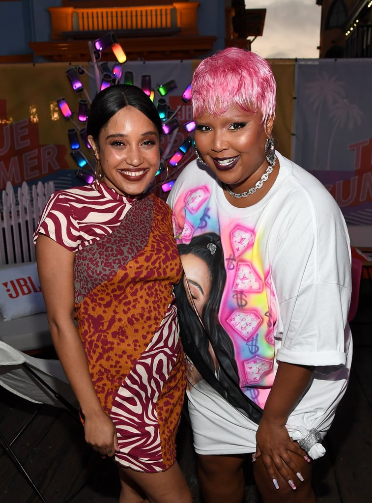 """Lizzo's summer hair journey continues, and her latest look is a hot pink pixie cut so bright we might need sunglasses just to look it. Channeling the pink summer hair trend of this year, Lizzo debuted her new look during a day out with friends at the JBL True Summer exclusive event in LA on July 8. The wig — which some might deem magenta, fuchsia, or even bubblegum — matched perfectly with her oversized shirt dress, which featured a spray-painted portrait of the """"Truth Hurts"""" singer herself surrounded by bright pink gemstones and dollar signs.  Lizzo completed the look with lots of bling and a pink and blue manicure adorned with matching floral appliques and rhinestones of varying sizes. Following the JBL event, she and her friends went out for dinner and drinks at Dreux's Louisiana FQ and spent the night serenading each other with their favorite karaoke songs. Like a symbol of summer fun, Lizzo's hot pink hair added an extra pop of color to their selfies for the evening, and we're more than a little tempted to follow her lead and try a bold hair color of our own this season.  Take a closer look at Lizzo's fun summer hairdo here.      Related:                                                                                                           These New Redhead Celebrities Prove the Hair-Color Trend Looks Hot on Everyone"""