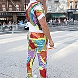 A guest wearing a rainbow sequin outfit with Comme Des Garçons sneakers.