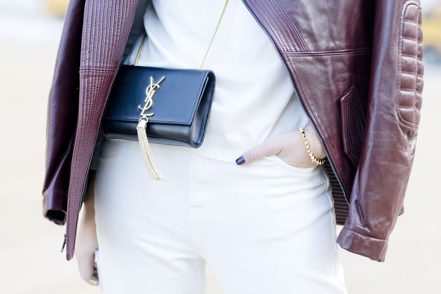 Delicate gold jewels and a dainty YSL bag were the perfect picks against Winter white and burgundy. Source: Tim Regas