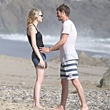 Emma Stone and Andrew Garfield shared a loving moment together on the beach.