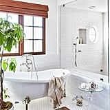 Practical renovations in the bathroom brought the home up to contemporary standards without compromising the home's architectural features. A cast iron claw-foot tub anchors the airy space.
