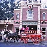 A horse-drawn carriage passed the Disneyland Fire Department building.