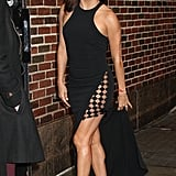 The star showed off her toned legs as she entered The Late Show With Stephen Colbert wearing this sexy black number.