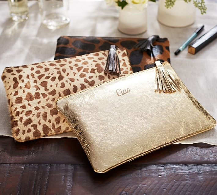 Amp up her makeup-bag game with this Gold Leather Travel Pouch ($39, $7 per monogram).