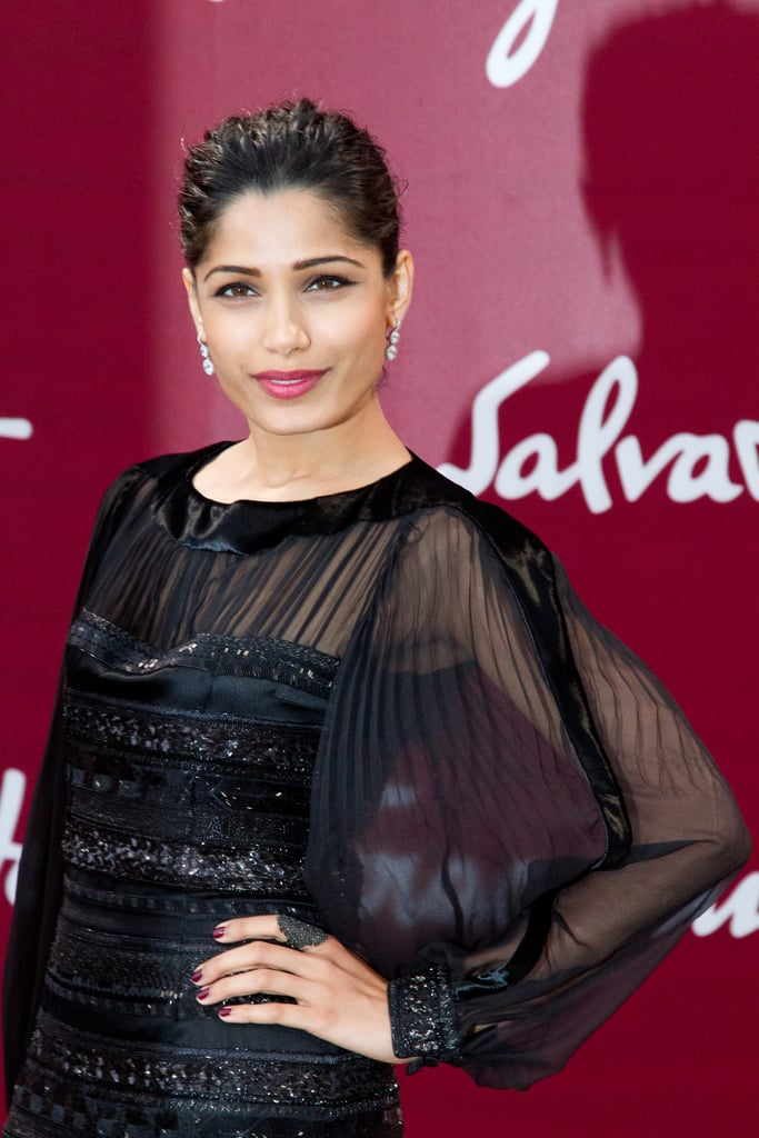 Freida Pinto smiled at the Salvatore Ferragamo Resort collection show in Paris.
