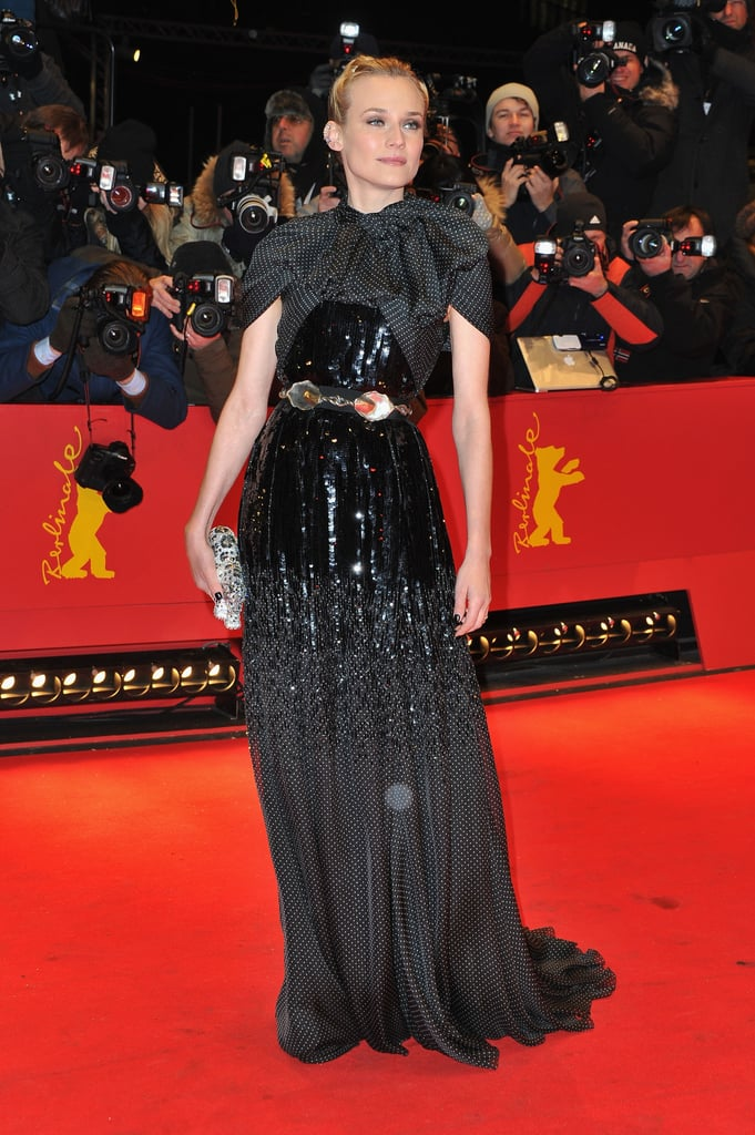 """All eyes were on Diane Kruger as she made her way down the red carpet at tonight's Berlin Film Festival premiere of Farewell, My Queen. She began the day at a photocall wearing a colorful look from 10 Crosby by Derek Lam and chatted with press, in her native German, about director Benoît Jacquot's dramatic Marie Antoinette tale. She spoke freely about the project, and even addressed the movie's over the top fashion. Diane said of the wardrobe, """"I personally hate historical films where people just look at dresses and hair. . . I had to forget that to do the film. . .You need to see the woman Marie Antoinette, not just the queen."""" For tonight's screening Diane went for a bolder look and turned up the sparkle factor in a beaded Giambattista Valli Couture gown, jeweled Judith Leiber clutch, and edgy cuff earrings. Diane and boyfriend Joshua Jackson are one of our favorite red-carpet pairs, and they're right at the top of our pre-Valentine's Day list of Hollywood's cutest couples. He couldn't be with her tonight, but she did have the company of the film festival's director, Dieter Kosslick."""