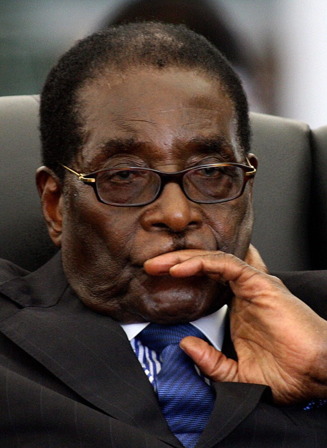 Zimbabwean President Robert Mugabe attends the swearing in ceremony of new Prime Minister Morgan Tsvangirai.