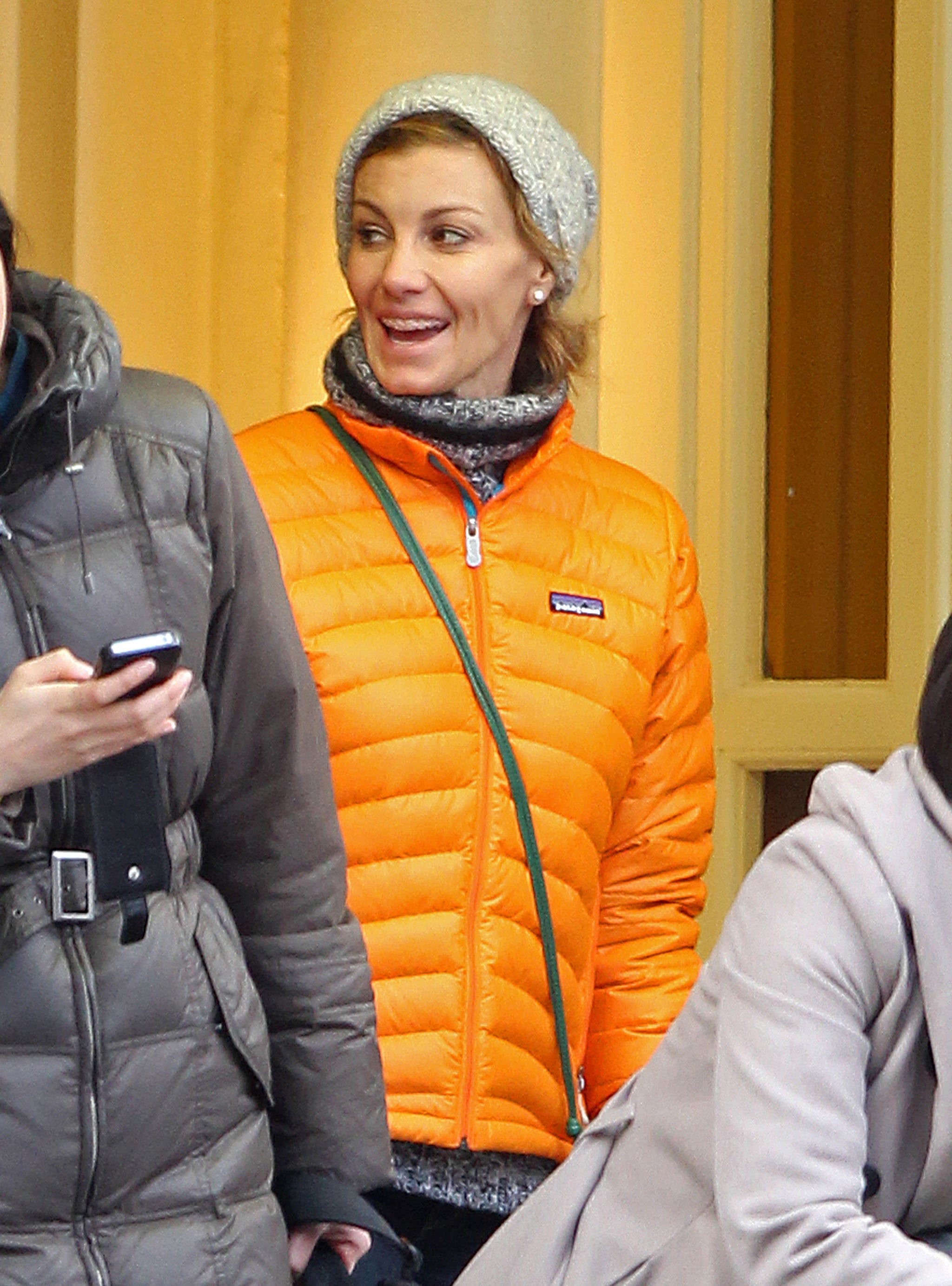 Faith Hill kept warm with a puffy orange jacket in London.