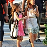 Suri Cruise chatted with her friend.