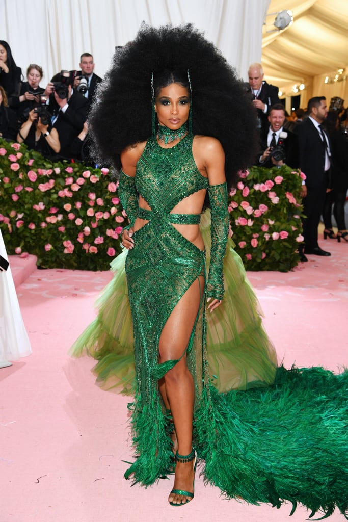 I'm sure many of you were distracted by Ciara's gorgeous, sky-high 'fro on the Met Gala red carpet on Monday night, but can we take a second to acknowledge her whole look? Because my girl looked like a goddess who showed up straight out of Emerald City in this jaw-dropping bright green gown. The dress, designed by Peter Dundas, was embellished with green sequins, and along with cutouts on her shoulders and both sides of her ribcage, the gown also featured a thigh-high slit and a feather train. Ciara accessorized the dress with a pair of matching elbow-length gloves and green, strappy sandals. Read ahead to see more photos of her glamorous getup from all angles, then check out all of this year's Met Gala looks.       Related:                                                                                                           Cardi B Came in Hot in a Fiery Red Peacock Gown Worthy of the Met Gala's Theme