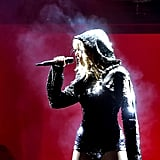 She Performs in a Sequined Black Hoodie