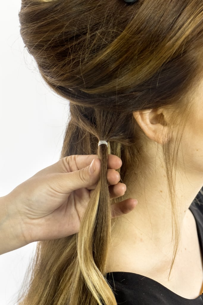 Take all your hair from ear level and up, and clip it out of the way for now. Take a small section of loose hair from behind each ear and combine them into a small ponytail behind your right ear (pictured). Fasten with a small, clear elastic. The finished result should look like a tiny side ponytail.