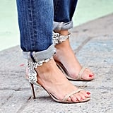 You wouldn't forget to cuff your jeans when you're sporting strappy sandals with details this pretty.