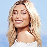 "Hailey Bieber's Unfiltered Opinion on That ""Pinky Finger"" Drama Speaking of being open (and frankly, bullying), her husband Justin Bieber's docuseries Changes gave a peek into the past few years of the singer's journey, peeling back the curtain on aspects of the couple's lives — all of which, naturally, opens you up to public scrutiny. Perhaps the most peculiar example of that was the spike in interest over Hailey Bieber's pinky finger across social media. She took to Instagram to explain the crooked nature was because of genetic condition, but took down the post shortly thereafter. ""I couldn't believe were even talking about it,"" she laughed. ""I was actually just trying to be funny [with the post]. Like a, if people were so curious about why that is, here's why. I think people took it wrong. They thought I was being dead serious. Like, 'Poor me. I deal with this condition in my finger.' I was actually making fun of myself. You know, I was trying to just poke fun at it and make it into a light situation. There are so many more important things happening in the world. I just think people took it the wrong way, which is why I actually ended up deleting it because I was trying to just be silly."" On Self-Care — and How Clean Beauty Plays Into It Being immersed in the day-to-day of modelling and beauty campaigns can sound exciting, but it can take a toll on your mental health — and skin. Since teaming up with BareMinerals (which is celebrating its 25th year on the market), Bieber says she's learned the importance of keeping it simple. ""I keep things superminimal in terms of treatments, but I'm all about at-home treatment stuff,"" she said. ""I love to be home and sit in a bath and do a mask and put oils all over body and pretend like I'm at a spa. Honestly, I think what you do at home matters more. I try to be conscious about using clean ingredients, which is why I love the Pureness skincare line from Bare and everything they do."" Hailey Bieber's Most Meaningful Tiny Tattoo (Present and Future) in Her Collection"