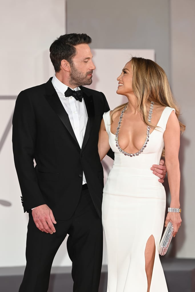 """Jennifer Lopez and Ben Affleck are showing their support for one another. After arriving together at the Venice International Film Festival on Thursday, the couple attended the premiere of Ben's new film The Last Duel on Friday. The appearance marks their first official red carpet appearance since getting back together in May. The two could be spotted holding hands and flashing big smiles as they walked the red carpet together.  The cute outing comes just a few months after they made their rekindled romance Instagram official. After they channeled their iconic """"Jenny From the Block"""" music video on a yacht in July, J Lo posted a photo of them kissing in celebration of her 52nd birthday. See some of their cutest pictures in Venice, Italy, ahead.       Related:                                                                                                           Jennifer Lopez and Ben Affleck Are Proof That Sometimes Love Is Worth a Second Chance"""