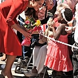 During a royal visit to Canada in July 2011, Kate knelt down to accept a bouquet from a young girl.
