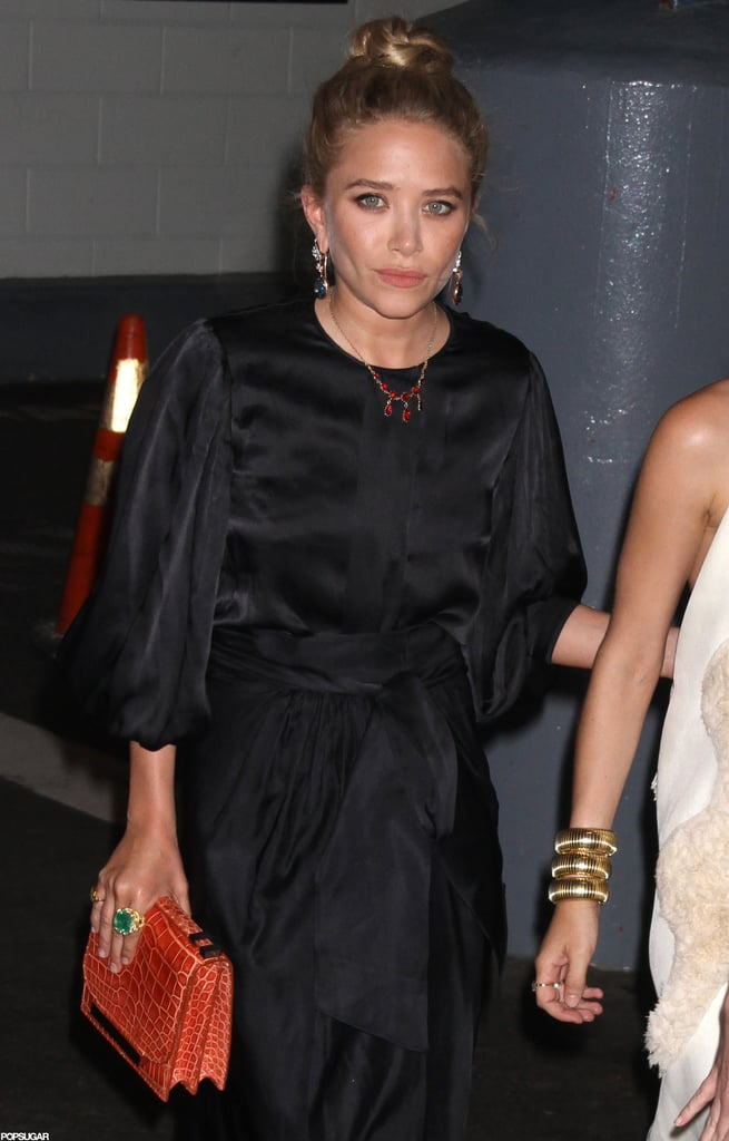 Mary-Kate Olsen wore a black silk dress with an orange clutch for the Fresh Air Fund's Spring Gala in NYC.