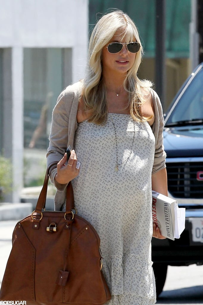 Sarah Michelle Gellar wore a light sweater with her dress.