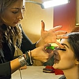 Karuna specializes in airbrush makeup and used Kett Cosmetics Hydro Foundation ($30) to perfect Mawra's radiant complexion. Here you can see Karuna applying Mawra's all-time favorite mascara, Maybelline Great Lash ($6).