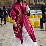 A Pleated Skirt and Clasped Silk Robe