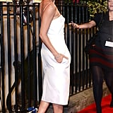 She paired her little white dress with classic black pumps in October 2013.