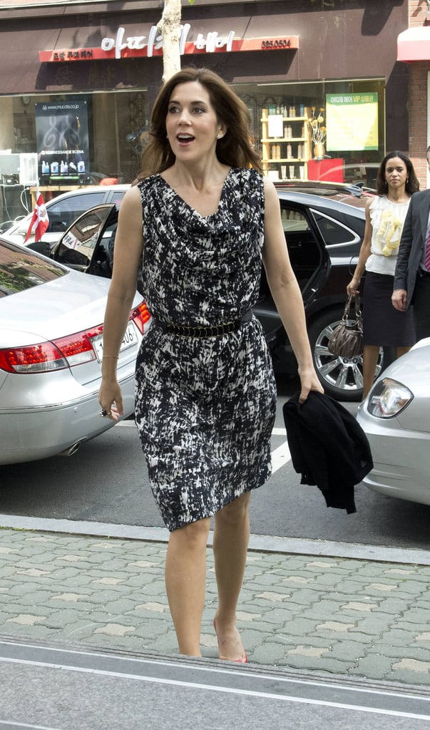 HRH opted for an abstract-printed dress for during the royal tour of South Korea. A leather belt cinched-in her waist.