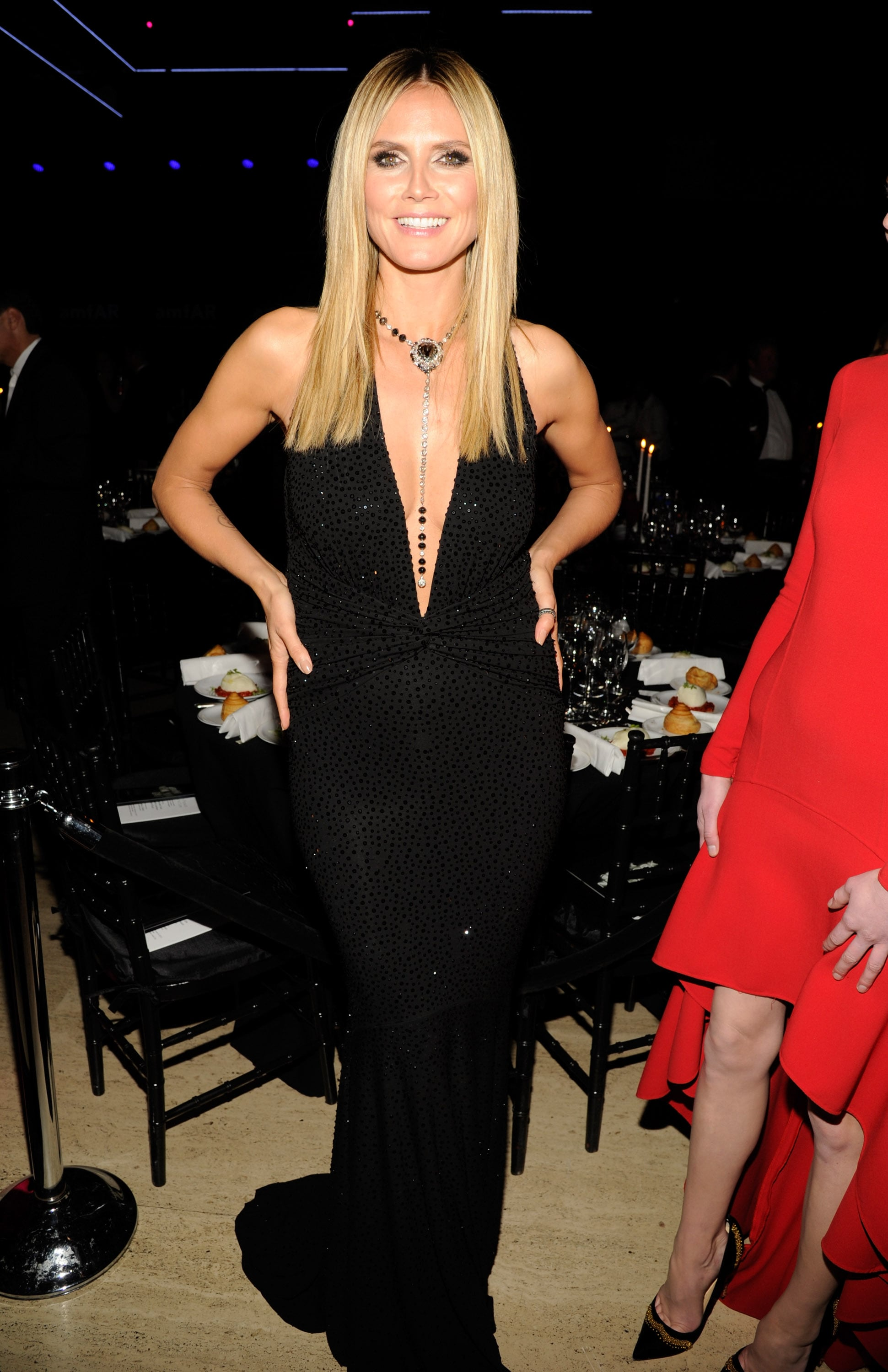 Heidi Klum wore a black sequined Michael Kors dress with a dangerously low neckline.